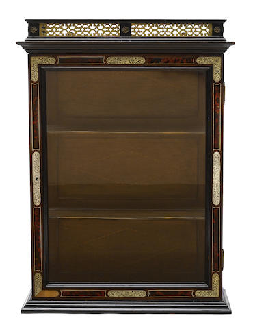 A Continental gilt metal mounted ivory inlaid wall cabinet