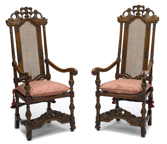 A pair of Flemish Baroque style caned walnut armchairs