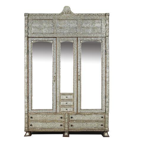 A Florentine inlaid mirrored armoire
