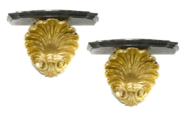 A pair of George II style parcel gilt and faux marble wall brackets