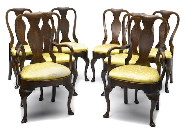 A set of eight George II style oak dining chairs