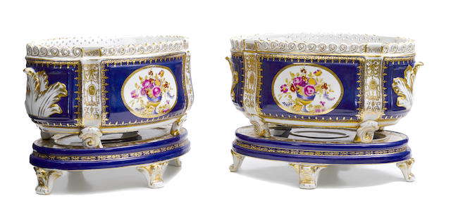 A pair of Sèvres style oval planters on porcelain bases