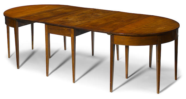A Federal walnut extension dining table in three parts