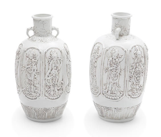A pair of blanc de chine relief decorated porcelain vases