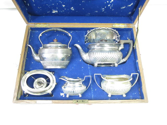 A cased composite silver tea service