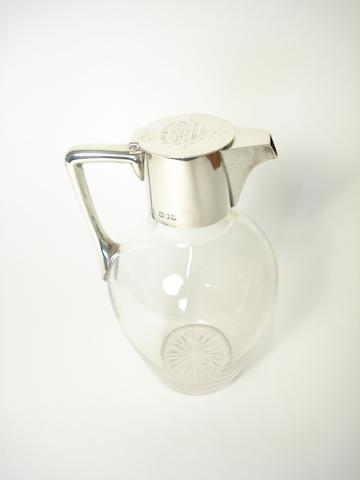 A late Victorian silver mounted glass claret jug