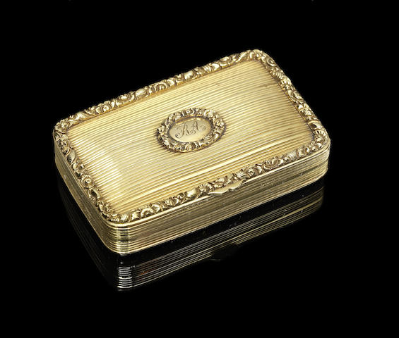 An early 19th century yellow metal snuff box, with later fitted silver gilt vinaigrette