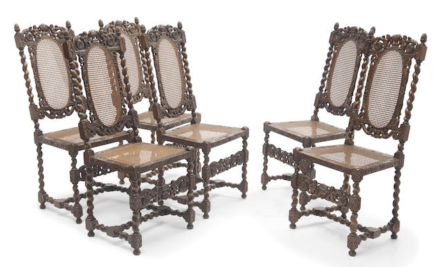 A set of six Renaissance style caned dining chairs