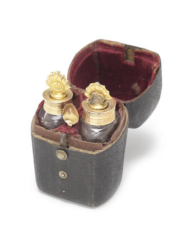 A pair of 19th century French gold-mounted scent bottles and spoon