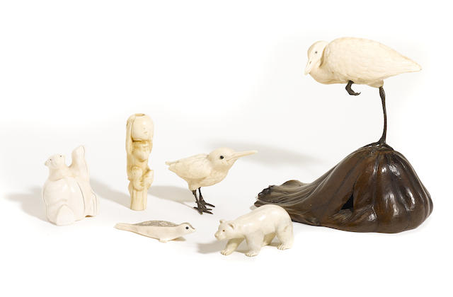 A grouping of carved ivory animal figures