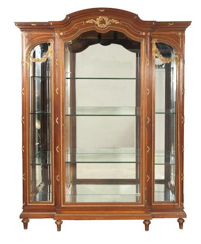 A Louis XVI style gilt bronze mounted mahogany vitrine cabinet