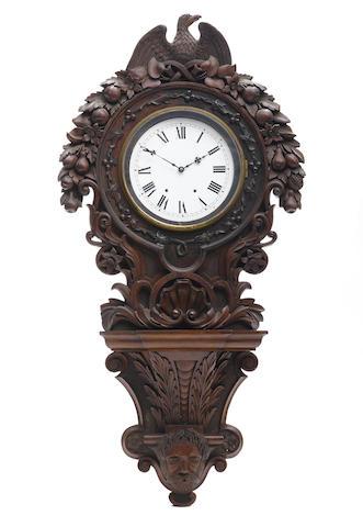 A Baroque Revival carved walnut bracket clock
