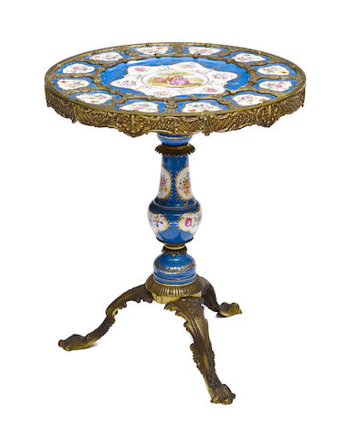 A Louis XV style gilt metal mounted porcelain gueridon