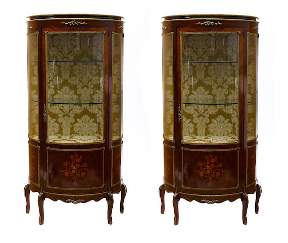 A pair of Louis XVI style gilt metal mounted marquetry and mahogany vitrines