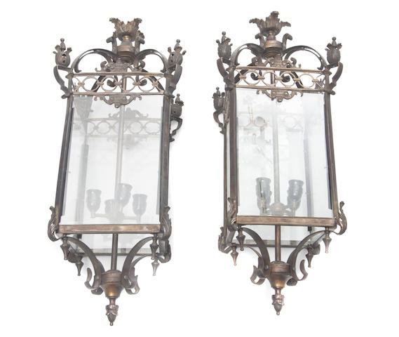 A pair of bronze lanterns with etched glass paneled sides