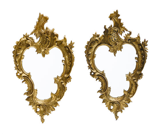 A pair of French style gilt cartouche shaped mirrors
