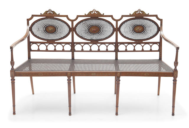 An Edwardian paint decorated caned settee