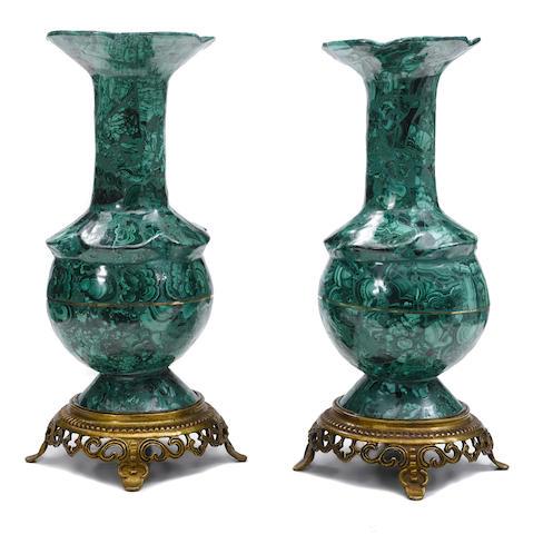 A pair of malachite vases on gilt bronze bases