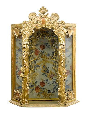 A Continental parcel gilt polychrome painted altar vitrine