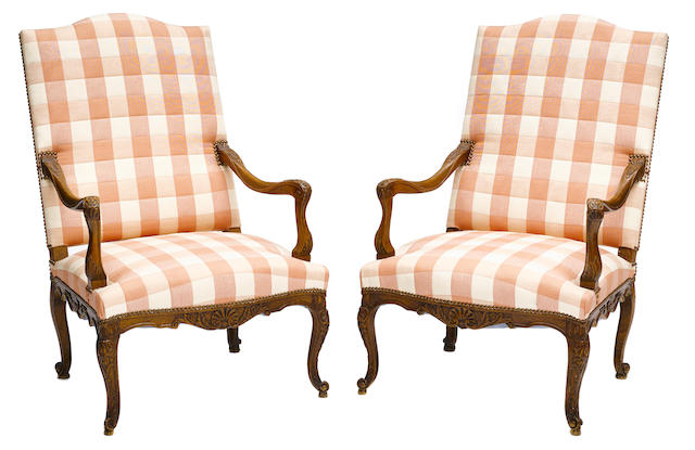 A pair of Louis XV style carved beechwood and upholstered armchairs