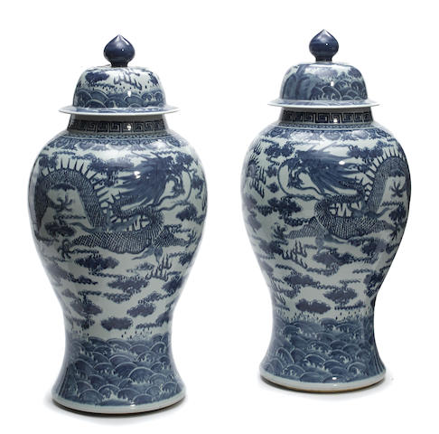 A pair of Continental Chinese blue and white tall covered jars
