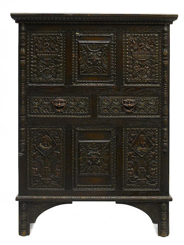 A Renaissance Revival carved oak side cupboard
