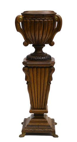A Neoclassical style brass mounted oak jardinière on a pedestal