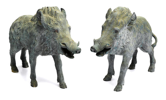 A large pair of bronze models of boars