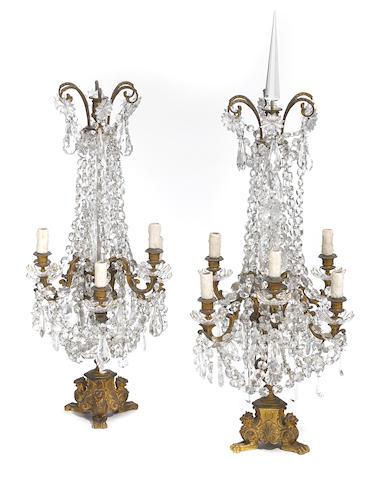A pair of French gilt bronze and glass six light girandoles