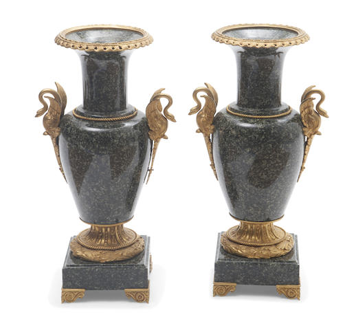 A pair of Louis XVI style bronze mounted marble urns