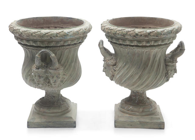 A pair of Régence style patinated bronze urns