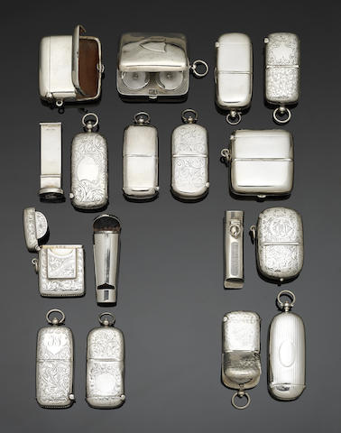 A collection of seventeen silver combined vesta cases and sovereign cases