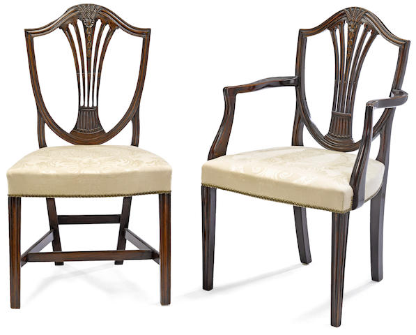 A matched set of twelve George III and George III style mahogany dining chairs