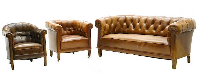 A suite of leather upolstered library furniture