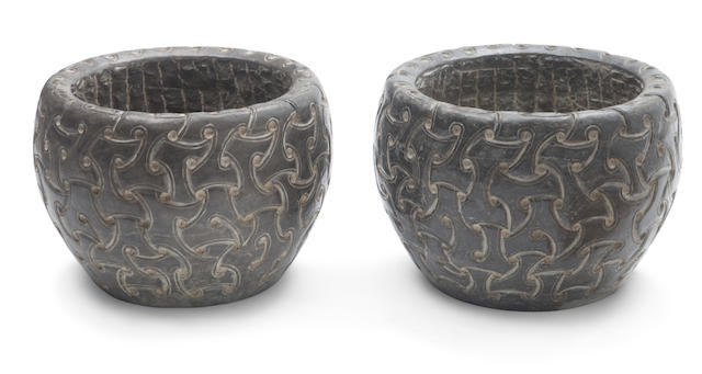 A pair of Celtic style carved stone planters
