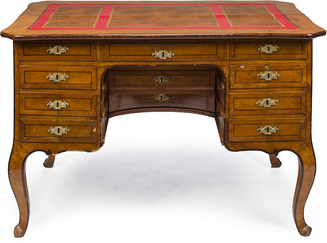 A Continental Rococo inlaid fruitwood kneehole writing desk