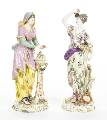 A pair of French porcelain figures emblematic of autumn and winter