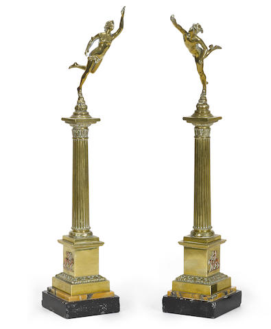 A pair of Italian brass and mixed marble columns surmounted with a figures of Mercury or Diana