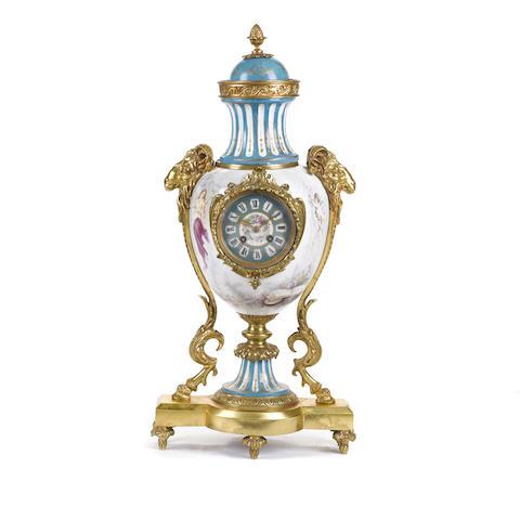 A French gilt bronze mounted Sèvres style porcelain mantel clock
