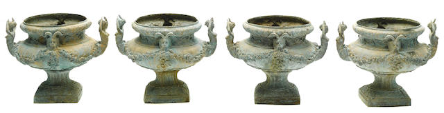 Two pairs of bronze urns
