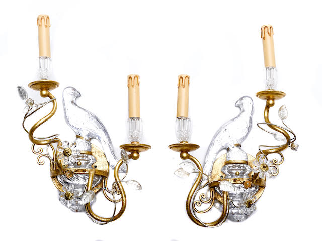 A pair of gilt and glass two light wall lights