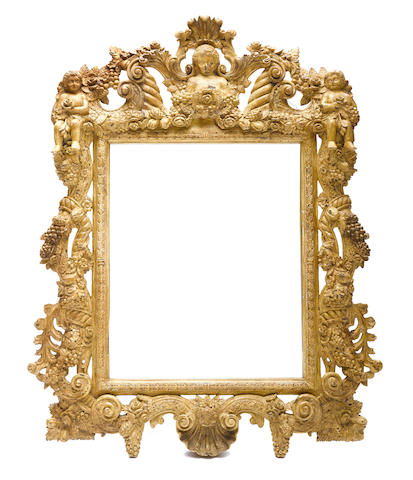 A Baroque style paint decorated mirror