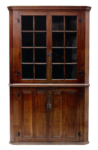 An American walnut corner cupboard