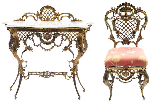 A three piece gilt bronze vanity set