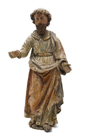 A Continental Baroque polychrome decorated carved wood figure of a saint