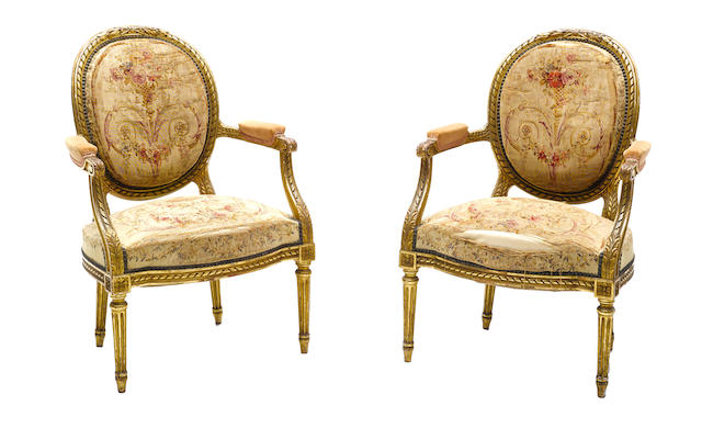 A pair of Louis XVI style tapestry upholstered giltwood fauteuils