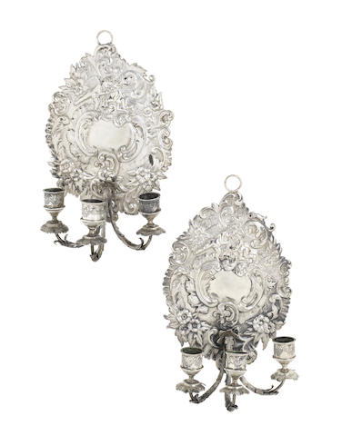 A pair of continental silver three-light wall sconces