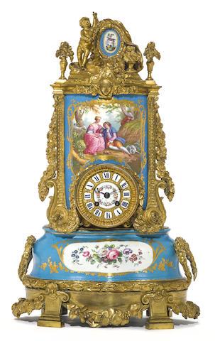 A Louis XVI style gilt bronze mounted porcelain mantel clock