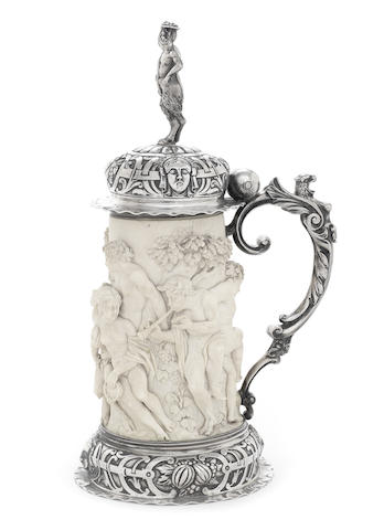 A 19th century German silver-mounted ivory tankard