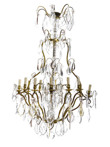 A Louis XV style gilt metal cut and molded glass twelve light chandelier